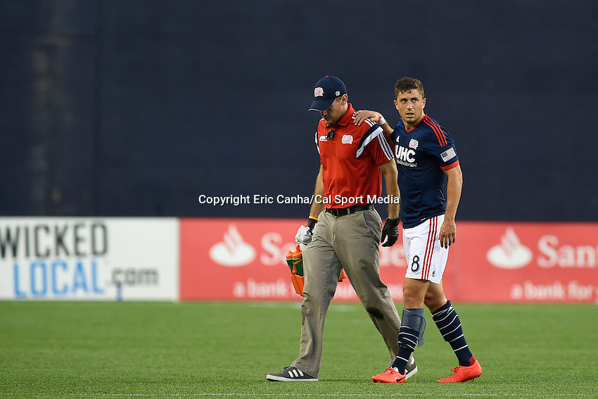 July 26, 2014 - Foxborough, Massachusetts, U.S. - New England Revolution defender Chris Tierney (8) leaves the pitch after being injured during the MLS game between the Columbus Crew and the New England Revolution held at Gillette Stadium in Foxborough Massachusetts.  Eric Canha/CSM
