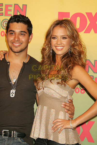 WILMER VALDERRAMA & JESSICA ALBA.2006 Teen Choice Awards held at the Gibson Amphitheatre, Universal City, California, USA..August 20th, 2006 .Ref: ADM/RE.half length brown top beige hand on hip.www.capitalpictures.com.sales@capitalpictures.com.©Russ Elliot/AdMedia/Capital Pictures.