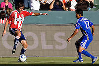 CD Chivas USA forward Alan Gordon dances around Wizards defender Roger Espinoza. The Kansas City Wizards defeated CD Chivas USA 2-0 at Home Depot Center stadium in Carson, California on Sunday September 19, 2010.