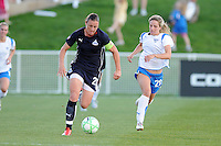 Washington Freedom forward Abby Wambach (20) runs with the ball and chase by Boston Breakers defender Sue Weber (20).   Boston Breakers defeated The Washington Freedom 3-1 at The Maryland SoccerPlex,  Saturday April 18, 2009.