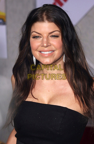 "FERGIE (STACY FERGUSON).""When In Rome"" Los Angeles Premiere - Arrivals held at The El Capitan Theater, Hollywood, CA, USA, .27th January 2010..portrait headshot black strapless cleavage .CAP/ADM/CH.©Charles Harris/AdMedia/Capital Pictures"