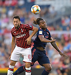 Hakan Calhanoglu (10, left) of Milan and Renato Sanches (35) of Bayern Munich leap for a header during their International Champions Cup match on July 23, 2019 at Children's Mercy Park in Kansas City, KS.<br /> Tim VIZER/AFP