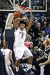 Nevada's AJ West (3) dunks against Utah State during an NCAA college basketball game in Reno, Nev., on Tuesday, Jan. 20, 2015. (AP Photo/Cathleen Allison)