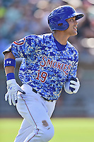 Tennessee Smokies right fielder Jacob Hannemann (19) runs to first during a game against the Birmingham Barons on August 2, 2015 in Kodak, Tennessee. The Smokies defeated the Barons 5-2. (Tony Farlow/Four Seam Images)