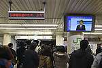 March 17, 2011, Tokyo, Japan - Commuters at Shinbashi Station in Tokyo keep their eyes on station announcements and the TV news as they brace for a possible power outage planned in an attempt to conserve electricity. The power grid has been impacted heavily by the recent earthquake and its aftermath. (Photo by YUTAKA/AFLO) [1040]