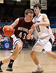 SIOUX FALLS, SD - MARCH 20:  Will Steineke #43 from Tri-Valley tries to drive past Trae VandeBerg #10 from Madison in the second half of their quarterfinal game Thursday afternoon at the Class A Boys Basketball Championship at the Sioux Falls Arena. (Photo by Dave Eggen/Inertia)