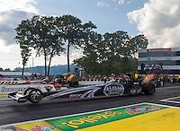 May 30, 2014; Englishtown, NJ, USA; NHRA top fuel driver Shawn Langdon during qualifying for the Summernationals at Raceway Park. Mandatory Credit: Mark J. Rebilas-