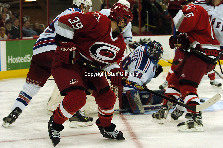 Carolina Hurricanes' Doug Weight (39) threads a pass through the crease despite the New York Rangers' defense, including goaltender Kevin Weekes (80) Tuesday, March 14, 2006 at the RBC Center in Raleigh, NC. Carolina won 5-3.