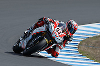 Michel Fabrizio (ITA) riding the Aprilia RSV4 1000 Factory (84) of the Red Devils Roma team rounds turn 6 during a qualifying session on day one of round one of the 2013 FIM World Superbike Championship at Phillip Island, Australia.