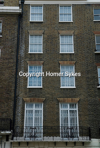 The Royal Borough of Kensington and Chelsea. Security bars on town house. Wilton Terrace. London SW1 England. 2006