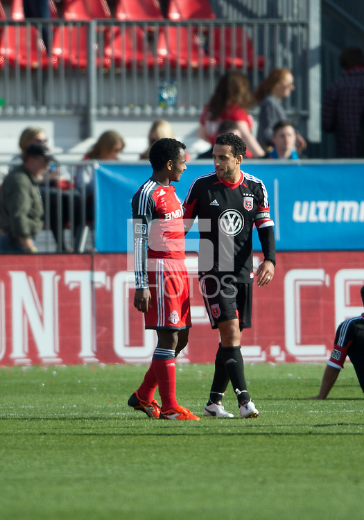 05 May 2012: D.C. United midfielder Dwayne De Rosario #7 talks with Toronto FC midfielder Julian de Guzman #6 at the end of an MLS game between DC United and Toronto FC at BMO Field in Toronto..D.C. United won 2-0.