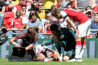 Arsenal goalkeeper Petr Cech, consoles teammate Per Mertesacker as he receives treatment for a cut to his head. Blood can be seen on the hands of the Arsenal defender during Arsenal vs Chelsea, FA Community Shield Football at Wembley Stadium on 6th August 2017