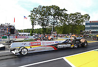 May 31, 2013; Englishtown, NJ, USA: NHRA top fuel dragster driver Larry Dixon (near lane) races alongside Terry McMillen during qualifying for the Summer Nationals at Raceway Park. Mandatory Credit: Mark J. Rebilas-