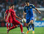 (L) Yingzhi Ju of Hong Kong competes for the ball with (R) Enzo Perez of Argentina during the HKFA Centennial Celebration Match between Hong Kong vs Argentina at the Hong Kong Stadium on 14th October 2014 in Hong Kong, China. Photo by Aitor Alcalde / Power Sport Images
