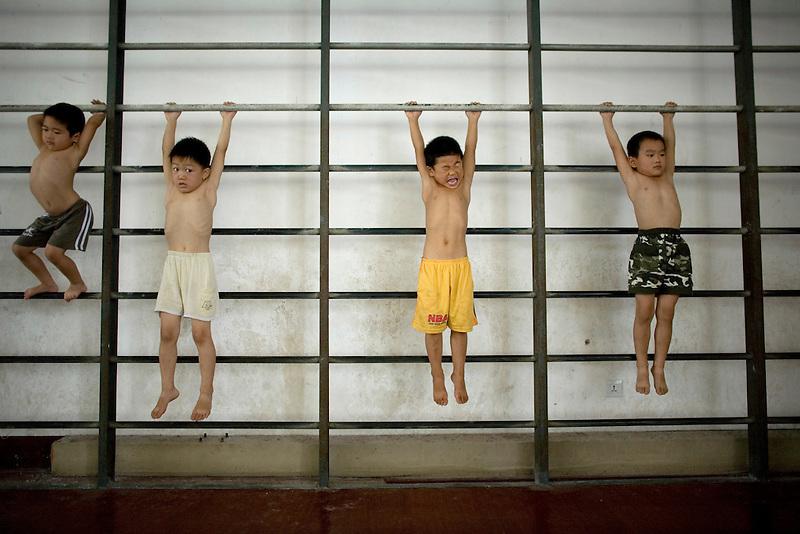 Chinese children train in a gymnastics school in Xiantao, in Hubei province