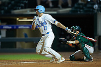 Cody Roberts (11) of the North Carolina Tar Heels follows through on his swing against the Miami Hurricanes in the second semifinal of the 2017 ACC Baseball Championship at Louisville Slugger Field on May 27, 2017 in Louisville, Kentucky. The Tar Heels defeated the Hurricanes 12-4. (Brian Westerholt/Four Seam Images)