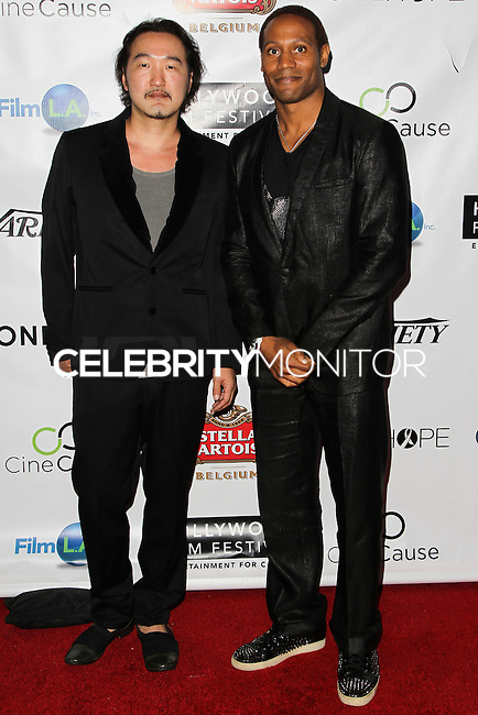 HOLLYWOOD, LOS ANGELES, CA, USA - OCTOBER 16: Yasu Shibuya, Dante Carver arrive at the 2014 Hollywood Film Festival - Opening Night Gala held at ArcLight Hollywood on October 16, 2014 in Hollywood, Los Angles, California, United States. (Photo by Celebrity Monitor)