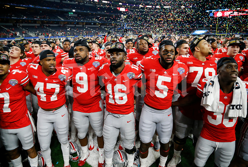 "The Ohio State Buckeyes sing ""Carmen Ohio"" following their 24-7 victory against the USC Trojans during the Goodyear Cotton Bowl Classic on Friday, December 29, 2017 at AT&T Stadium in Arlington, Texas. [Joshua A. Bickel/Dispatch]"