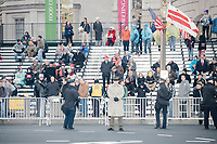 People gather along Pennsylvania Avenue to watch the inaugural parade of President Donald Trump on Jan. 20, 2017, in Washington, D.C.