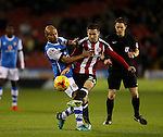 Danny Lafferty of Sheffield Utd tussles with Adam Chambers of Walsall during the English League One match at Bramall Lane Stadium, Sheffield. Picture date: November 29th, 2016. Pic Simon Bellis/Sportimage