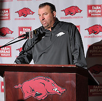 NWA Media/ANDY SHUPE - Arkansas coach Bret Bielema speaks to members of the media Monday, Dec. 22, 2014, during a press conference ahead of the Razorbacks' Dec. 29 bowl game with Texas in Houston.
