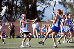 Santa Barbara, CA 02/13/10 - Leah Manooch (Florida # 9) and Maggie Aker (UCSB # 9) in action during the UCSB-Florida game at the 2010 Santa Barbara Shoutout, UCSB defeated Florida 9-8.
