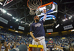 Nevada's Cody Martin cuts down the net after their win over Colorado State for the Mountain West Championship in a NCAA college basketball game in Reno, Nev., Sunday, Feb. 25, 2018. (AP Photo/Tom R. Smedes)