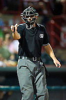 Home plate umpire Travis Hatch during an Eastern League game between the Erie Seawolves and Altoona Curve at Jerry Uht Park on August 31, 2012 in Erie, Pennsylvania.  Altoona defeated Erie 4-3.  (Mike Janes/Four Seam Images)