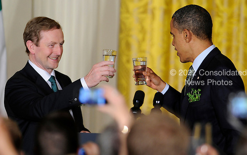 United States President Barack Obama (R) toasts with Irish Prime Minister Enda Kenny during a reception in the East Room of the White House, March 20, 2012, in Washington, DC. The two leaders concluded a working day devoted to discussions on economic matters, Ireland's peace keeping participations and foreign policy issues like Syria and Iran.        .Credit: Mike Theiler / Pool via CNP