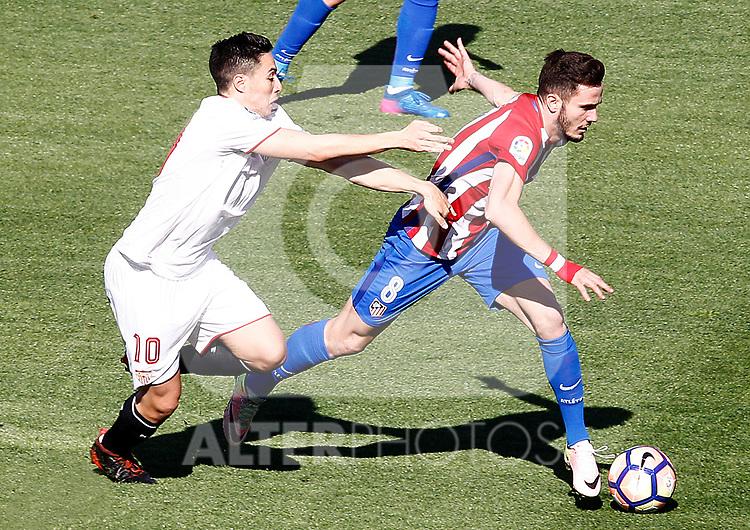 Atletico de Madrid's Saul Niguez (r) and Sevilla FC's Samir Nasri during La Liga match. March 19,2017. (ALTERPHOTOS/Acero)