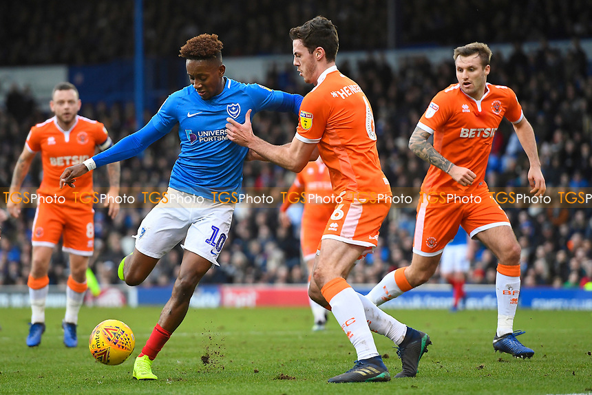 Jamal Lowe of Portsmouth is held up by Ben Heneghan of Blackpool during Portsmouth vs Blackpool, Sky Bet EFL League 1 Football at Fratton Park on 12th January 2019