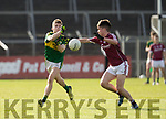 Kerry's Gavin White and Galway's Peter Cooke in action during the Kerry V Galway Under 21 Football Championship semi final at Cusack Park, Ennis on Sunday. Photograph by Eamon Ward