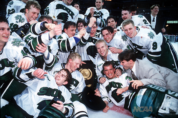 29 Mar 1997: The University of North Dakota hockey team crowds the trophy after the Division 1 Men's Hockey Finals at the Bradley Center in Milwaukee, WI. North Dakota defeated Boston University, 6-4, to win the title. Vincent Muzik/NCAA Photos.