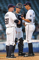 NWA Democrat-Gazette/ANDY SHUPE<br /> Northwest Arkansas Naturals pitching coach Jim Brower (left) speaks with starter Kyle Zimmer (right) as catcher Parker Morin listens against San Antonio Wednesday, Aug. 12, 2015, during the fifth inning at Arvest Ballpark in Springdale.