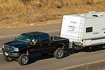 Lifted Ford Super Duty towing travel trailer