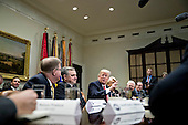 U.S. President Donald Trump, center, speaks as he meets with county sheriffs during a listening session in the Roosevelt Room of the White House in Washington, D.C., U.S., on Tuesday, Feb. 7, 2017. The Trump administration will return to court Tuesday to argue it has broad authority over national security and to demand reinstatement of a travel ban on seven Muslim-majority countries that stranded refugees, triggered protests and handed the young government its first crucial test. <br /> Credit: Andrew Harrer / Pool via CNP