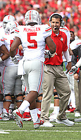 Ohio State defensive coach Mike Vrabel congratulates *Ohio State Buckeyes linebacker Raekwon McMillan (5) during second half play at Byrd Stadium on October 4, 2014.  (Chris Russell/Dispatch Photo)