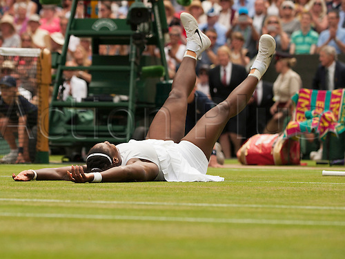 09.07.2016. All England Lawn Tennis and Croquet Club, London, England. The Wimbledon Tennis Championships Day 13.  Serena Williams (USA) falls to the court after winning the women's singles title against Angelique Kerber (GER)