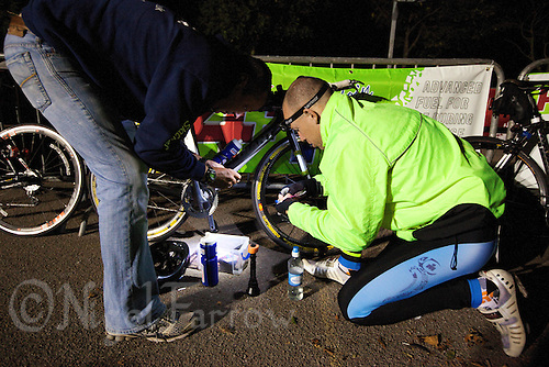 07 AUG 2010 - LICHFIELD, GBR - Iain Grommett makes repairs to his bike during the Enduroman Ultra Triathlon Double Iron Championships (PHOTO (C) NIGEL FARROW)