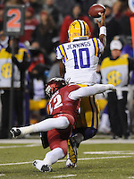 NWA Media/ANDY SHUPE - Arkansas' Josh Williams (42) reaches to bring down LSU's Anthony Jennings (10) during the second quarter Saturday, Nov. 15, 2014, at Razorback Stadium in Fayetteville.