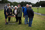 Spectators paying admission and buying raffle tickets at Millburn Park, Alexandria, before Vale of Leven hosted Ashfield in a West of Scotland League Central District Second Division Junior fixture. Vale of Leven were one of the founder members of the Scottish League in 1890 and remained part of the SFA and League structure until 1929 when the original club folded, only to be resurrected as a member of the Scottish Junior Football Association after World War II. They lost the match to Ashfield by 4-3, having led 3-1 with 10 minutes remaining.