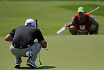 Cromwell, CT-22 JUNE 22 2018-062219MK05 Matt Jones and his caddie eye the putt line on the 15th green Saturday morning during the third round of the 2019 Travelers Championship at the TPC River Highlands in Cromwell. Cantlay finished the round five under par with a score of 65. Michael Kabelka / Republican-American