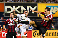 Daniele Bonera (25) of A. C. Milan plays the ball in front of Cristiano Ronaldo (7) of Real Madrid. Real Madrid defeated A. C. Milan 5-1 during a 2012 Herbalife World Football Challenge match at Yankee Stadium in New York, NY, on August 8, 2012.