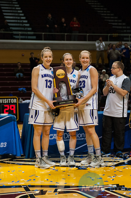 GRAND RAPIDS, MI - MARCH 18: Amherst College team captains pose with the winning trophy during the Division III Women's Basketball Championship held at Van Noord Arena on March 18, 2017 in Grand Rapids, Michigan. Amherst College defeated Tufts University 52-29 for the national title. (Photo by Brady Kenniston/NCAA Photos via Getty Images)