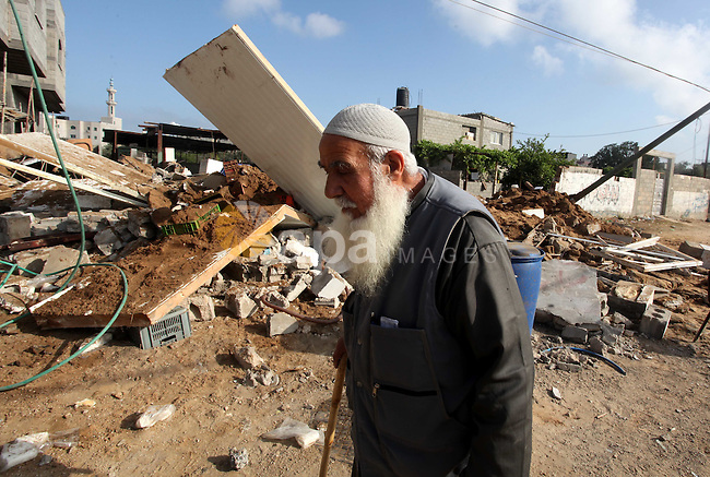 A Palestinian man inspects the damage at a cheese factory in Gaza City on June 4, 2012 following an Israeli air strike on the Gaza Strip on June 3. Emergency medical sources in Gaza said seven Palestinians were wounded in four strikes, two on targets east of Khan Yunis in the southern part of the territory, and two that hit Beit Lahiya in the northern section of the Strip. Photo by Yasser Fathi