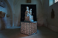 Statue of Virgin and child by Jean Degoulon, 1679, on a pedestal made from silver glass beads made by Murano glassmaker Salviati, and behind, velvet wall hangings with sequins made in 2014 by Atelier du Begonia d'Or, in St Thibaud's Chapel, themed as the Lapidary, in Le Tresor de la Cathedral d'Angouleme, in Angouleme Cathedral, or the Cathedrale Saint-Pierre d'Angouleme, Angouleme, Charente, France. The 12th century Romanesque cathedral was largely reworked by Paul Abadie in 1852-75. In 2008, Jean-Michel Othoniel was commissioned by DRAC Aquitaine - Limousin - Poitou-Charentes to display the Treasure of the Cathedral in some of its rooms, which opened to the public on 30th September 2016. Picture by Manuel Cohen. L'autorisation de reproduire cette oeuvre doit etre demandee aupres de l'ADAGP/Permission to reproduce this work of art must be obtained from DACS.