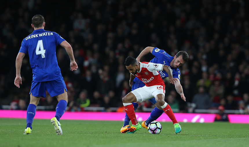 Arsenal's Theo Walcott shields the ball from Leicester City's Christian Fuchs<br /> <br /> Photographer Stephen White/CameraSport<br /> <br /> The Premier League - Arsenal v Leicester City - Wednesday 26th April 2017 - Emirates Stadium - London<br /> <br /> World Copyright &copy; 2017 CameraSport. All rights reserved. 43 Linden Ave. Countesthorpe. Leicester. England. LE8 5PG - Tel: +44 (0) 116 277 4147 - admin@camerasport.com - www.camerasport.com