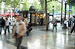 People walking along Champs Élysées in Paris after brief rain fall. Paris France