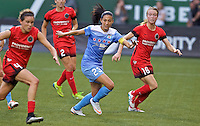 Portland, Oregon - Wednesday June 22, 2016: Chicago Red Stars forward Christen Press (23) and Portland Thorns FC defender Emily Sonnett (16) during a regular season National Women's Soccer League (NWSL) match at Providence Park.