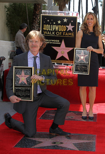 William H. Macy & Felictiy Huffman .Felictiy Huffman And William H. Macy Hollywood Walk Of Fame Induction Ceremony Held At On the Walk of Fame, Hollywood, California, USA.  .March 7th, 2012.full length moustache mustache facial hair married husband wife black suit dress suit kneeling .CAP/ADM/KB.©Kevan Brooks/AdMedia/Capital Pictures.